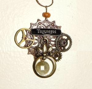 Steampunk, Motorcycle pin with influences of Chinese and Alice.