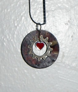 Simple pendant in mixed metals using sprocket gear, metal plate, and a heart from a card deck