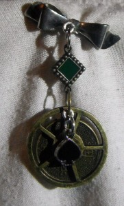 I made this using an old pin of my mother's and an earring I think was my sister's with some new gears and things.